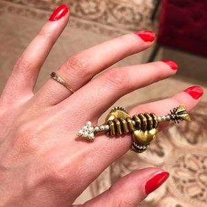 Jewelry - Hands holding arrow with pearls ring